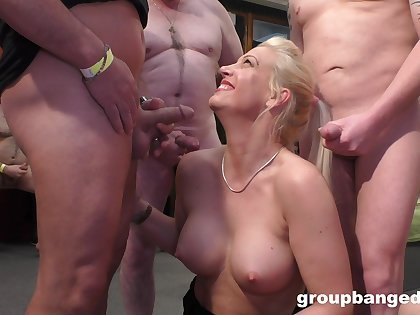 This lustful blonde MILF is a famous gang bang pornstar