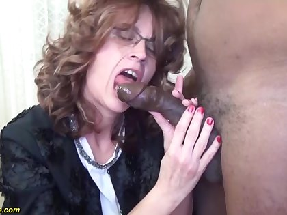 Curly hair mature about glasses enjoys a wild interracial ride from her jet BF
