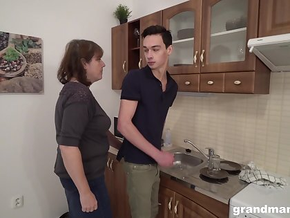 Sex-starved old landlady bangs young tenant right in rub-down the larder