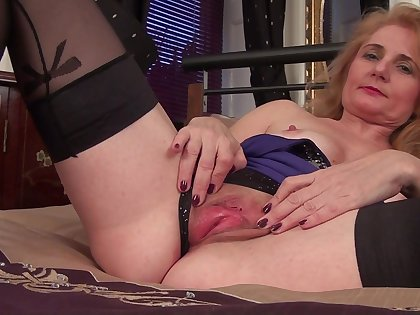 Amateur homemade video of mature Lily Roma playing thither will not hear of cunt